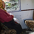 Woman On Train - Budapest by Madeline Ellis