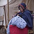Woman Reenactor Sewing In A Civil War Camp by Randall Nyhof