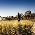Woman Running Through Field by Tim Hester