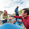 Woman Serving Appetizers, Alsek River by Josh Miller