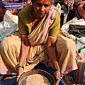 Woman Sifting In A Street Market India by Deborah Benbrook