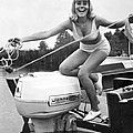 Woman Throwing A Boat Line by Underwood Archives