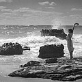 Woman Waving On Shore by Underwood Archives