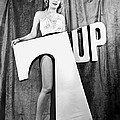 Woman With 7 Up Logo by Underwood Archives