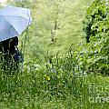 Woman With A Blue Umbrella by Mats Silvan