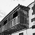 wooden balcony on ancient stucco covered traditional flat roofed house in tacoronte Tenerife Canary Islands Spain by Joe Fox
