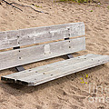 Wooden Bench Burried In The Sand by Les Palenik