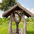 wooden shrine of holy Mother in Poland  by Arletta Cwalina