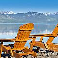 Wooden Deckchairs Overlooking Scenic Lake Laberge by Stephan Pietzko