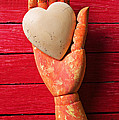 Wooden Hand With White Heart by Garry Gay