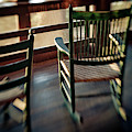 Wooden Rocking Chairs On A Deck by Kevin Steele