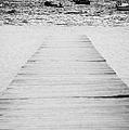 wooden walkway across beach leading down to boats in the sea Playa De Las Teresitas North Tenerife Canary Islands Spain by Joe Fox