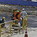 Workers Preparing The Road Surface And Sides Preparing For The Formula 1 by Ashish Agarwal