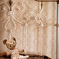 Worn Teddy Bear On Brass Bed by Jill Battaglia