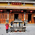 Worshipers In Urn Courtyard Of Chinese Temple Shanghai China by Imran Ahmed