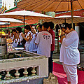 Worshippers In Front Of The Royal Temple  At Grand Palace Of Tha by Ruth Hager