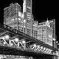 Wrigley Building At Night In Black And White by Sebastian Musial