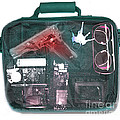 X-ray Of A Briefcase With A Gun by Scott Camazine
