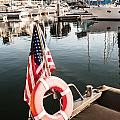 Yacht With American Flag At The Pier  by Sviatlana Kandybovich