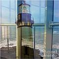 Yaquina Head Lighthouse Mirage  by Susan Garren