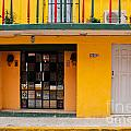 Yellow Buidling Mexico by Thomas Marchessault