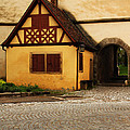 Yellow Building And Wall In Rothenburg Germany by Greg Matchick