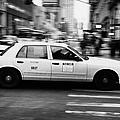 Yellow Cab Blurring Past Crosswalk And Pedestrians New York City Usa by Joe Fox
