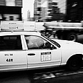 Yellow Cab With Advertising Hoarding Blurring Past Crosswalk And Pedestrians New York City Usa by Joe Fox