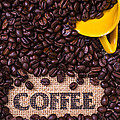 Yellow Coffee Cup With Coffee Beans by Garry Gay