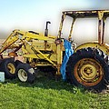Yellow Ford Tractor by Thomas Woolworth