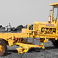 Yellow Grader by Guy Whiteley
