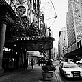 yellow taxi cab waits outside entrance to Macys department store on Broadway and 34th street by Joe Fox