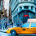 Yellow Taxi In Front Of New York City's Flatiron Building by Chaz Seymour