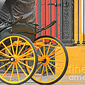 Yellow Wheeled Carriage In Seville by Holly C. Freeman