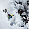 Young Adult Snowboarding Off Powder by Patrick Orton