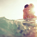 Young Couple Having Fun In The Sea by Nullplus