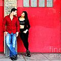 Young Couple Red Doors by Henrik Lehnerer