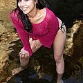 Young Hispanic Woman In Creek by Henrik Lehnerer