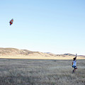 Young Lady Flies A Kite In An Open by Priscilla Gragg