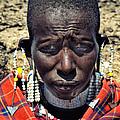 Portrait Of Young Maasai Woman At Ngorongoro Conservation Tanzania by Amyn Nasser