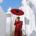 Young Novice Monk Walking On White Pagoda - Myanmar by Matteo Colombo