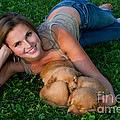 Young Woman And Golden Retriever Puppies by Linda Freshwaters Arndt