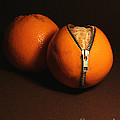 Zipped Oranges by Jaroslaw Blaminsky
