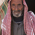 A Bedouin Man At The Camera In Front by Taylor S. Kennedy