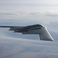A B-2 Spirit Soars Through The Sky by Stocktrek Images