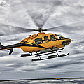 A Bell 407 Utility Helicopter Prepares by Terry Moore