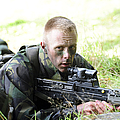 A British Soldier Armed With A Sa80 by Andrew Chittock