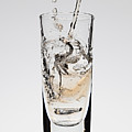A Drink Being Poured Into A Glass by Dual Dual