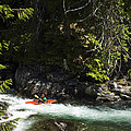 A Kayaker Paddles In A Rapid As Seen by Michael Hanson