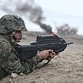 A Peruvian Marine Assaults A Beach by Stocktrek Images